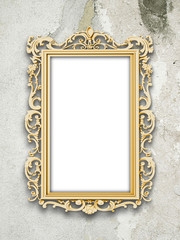 Single blank golden Baroque picture frames on gray concrete wall background