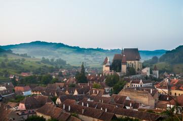 Beautiful Transylvanian saxon village and fortified church in morning sunlight
