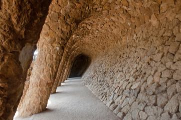 Barcellona, Spain - stone columns at Park Guell, the town art designed by Antoni Gaudi