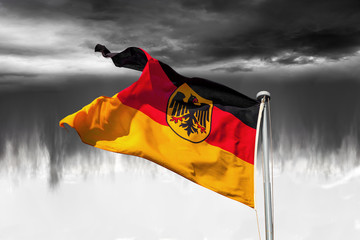The German national flag flying in the wind.