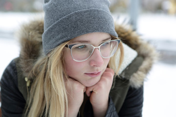 Portrait of thinking girl in glasses