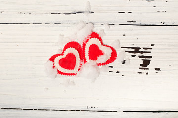 Two hearts on snow.
