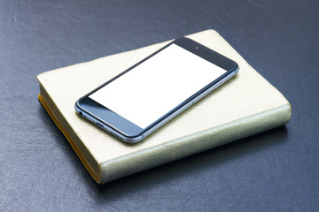 Back of the phone with golden notebook with empty screen mock up flat lay styled scene