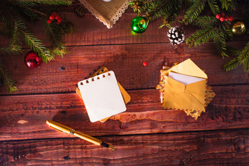 New Year greeting card on wooden table with decorations and christmas