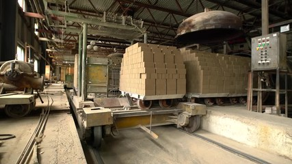 Wall Mural - Brickyard. View of transporting bricks at workshop
