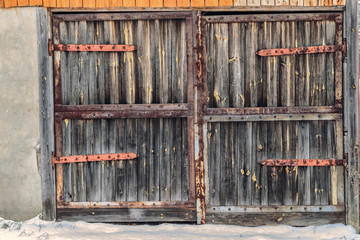 Old wooden door with rusty hinges