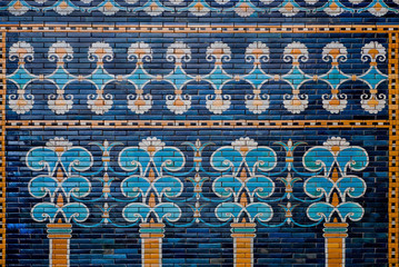 Ceramic coating with images of trees and patterns on the historical wall of Babylon, Pergamon Museum in Berlin