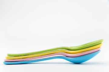colorful spoon on white isolate