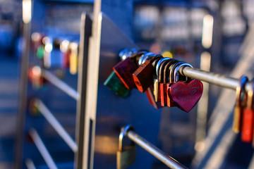 Love padlocks or love locks on a bridge in the harbor of hamburg on blurred sunlight background , love, paris, locks, lock, symbol, heart, white, romance, lifelong, padlock, red