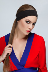 Pretty brunette woman in dressing gown wearing band on her head.