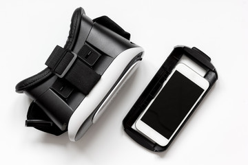 virtual reality glasses with smartphone on white background