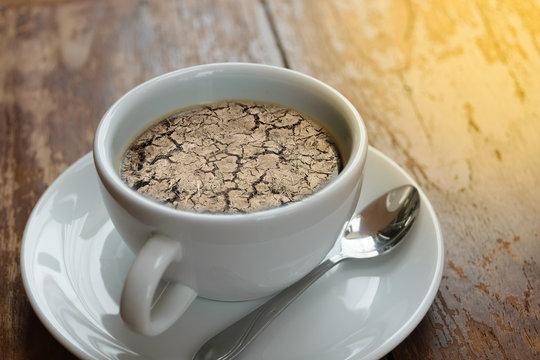 Dry cracked soil no rain on coffee