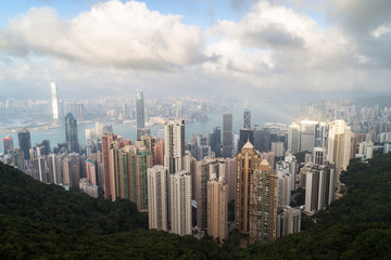Famous view of Hong Kong's skyline as seen from the Victoria Peak in daylight.