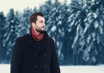Fashion portrait handsome elegant bearded man wearing black coat