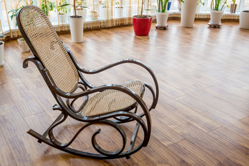Brown wicker rocking chair