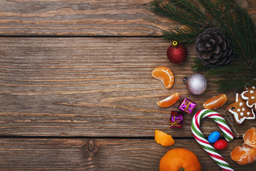 Christmas decorations on the right side on a wooden background