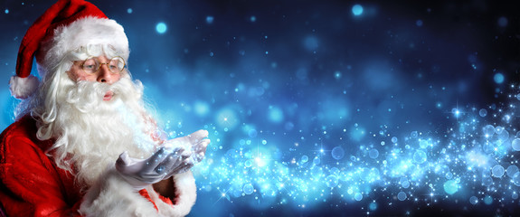 Santa Claus Blowing Magic Christmas Stars In Snowy Night  Wall mural