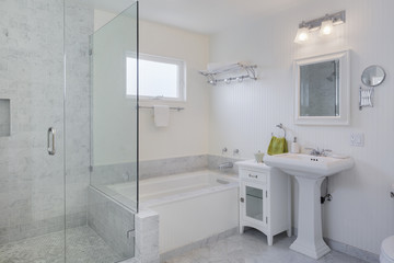 Modern marble tile bathroom with an open walk-in glass shower and bathtub