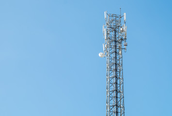 communication antenna tower, radio, television, telephone with a bright blue sky. background