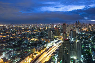 Bangkok at Night, City scape view on metropolis of Thailand and Cloudy blue sky
