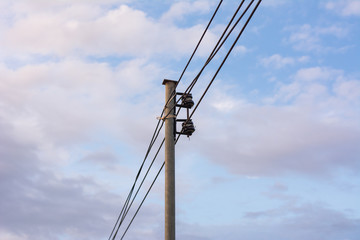 Electricity poles and wires cable with Cloud in the sky. The post power lines with power line cables