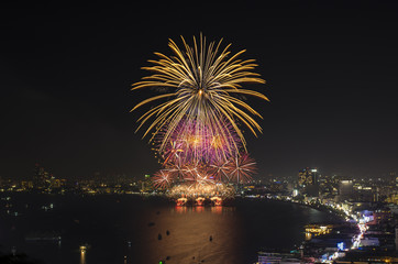 Multicolor fireworks night scene, pattaya cityscape sea beach vi