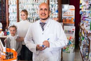 pharmacist  helping customers