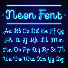 Glowing neon calligraphic letters on dark. Vector alphabet signs