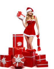 Stunning young female dressed in Christmas outfit posing seducti