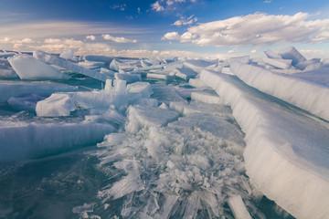 White сracked ice on the Baikal lake