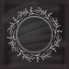 Vector floral frame on the chalkboard.