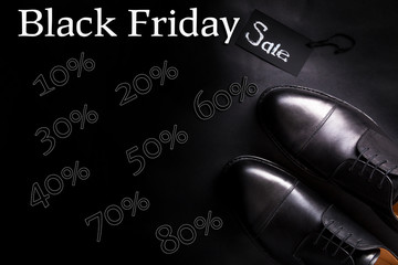 Black friday. Sale sign.  oxford shoes on  background. Top view.