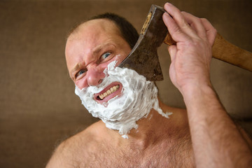 Man shaves with an ax