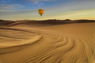 Hot Air Balloon in the desert at sunset background