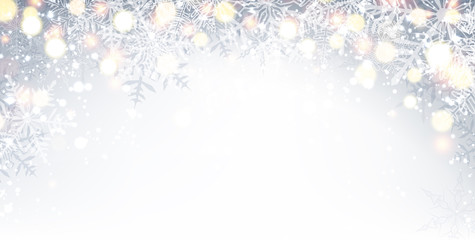 Gray winter background with snowflakes.