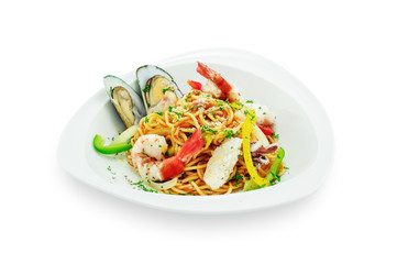 Spaghetti with seafood in white plate isolated