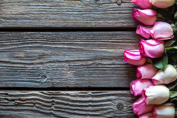 Pink roses bouquet over wooden table. Top view with copy space. flowers
