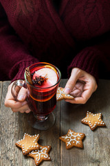 Christmas mulled wine in female hands