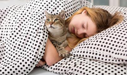 teen girl hug cat in bed, Girl and her Pet Cat