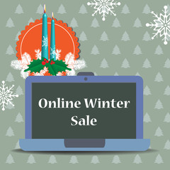 Colorful illustration with two burning candles, winter decorations and a laptop with the text online winter sale written on its screen