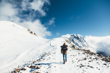 Hiker in mountains in winter