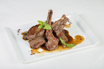 mutton grill with sauce on the white plate