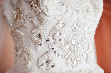 Closeup of brilliant and stones on wedding dress