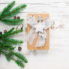 Holiday xmas gift in vintage style with green fir branches