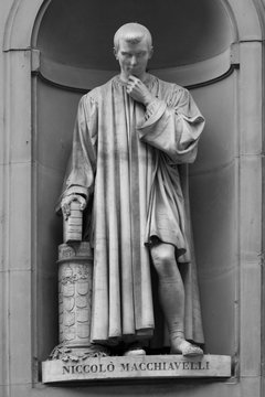 Statue of Italian Renaissance diplomat and writer Niccolo Machiavelli outside the Uffizi Gallery in Florence, Italy.