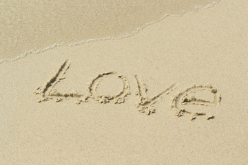 love, word drawn on the beach