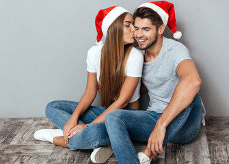 Fashion photo of christmas kissing couple