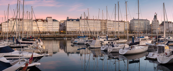 Panoramic view of touristic sea sport harbor with modernist architecture buildings at down in A Coruña, Galicia, Spain. Relaxing leisure touristic popular must see destination place in Corunna.