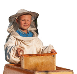 beekeeper a young boy who works in the apiary