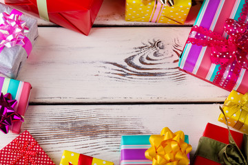 Christmas gifts around the old wooden background.